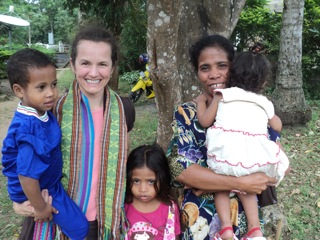 Monica with a family in East Timor